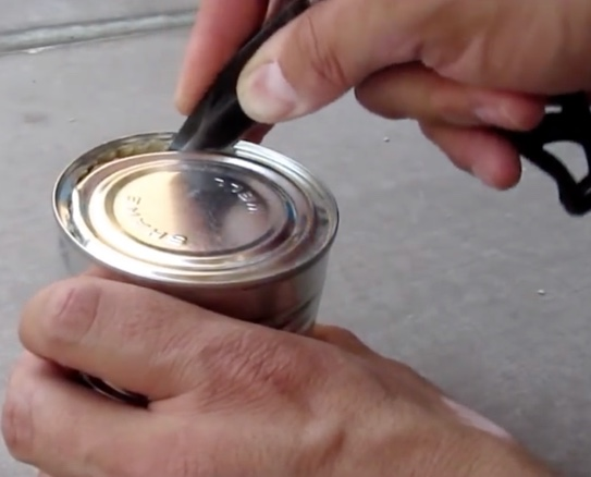 opening a can with a knife